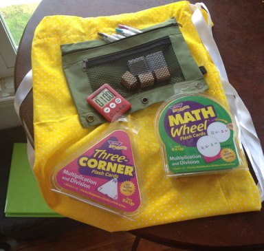 The Math Facts Pack goodies - stamps, pencils, timer, flashcards (and binder in the background)